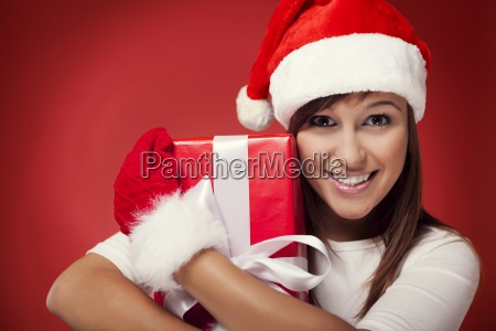 woman holding christmas present next to
