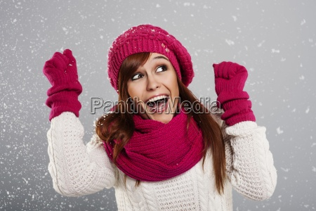 young woman enjoys first snow