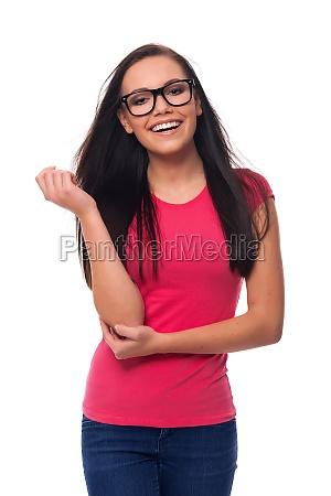 portrait of smiling brunette woman wearing