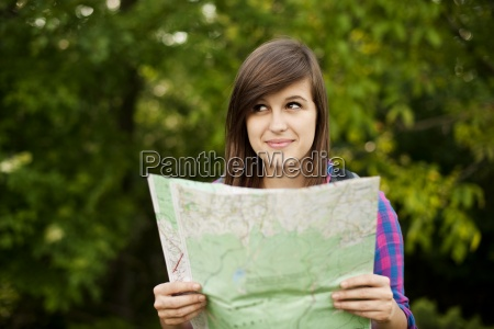 beautiful young woman holding a map