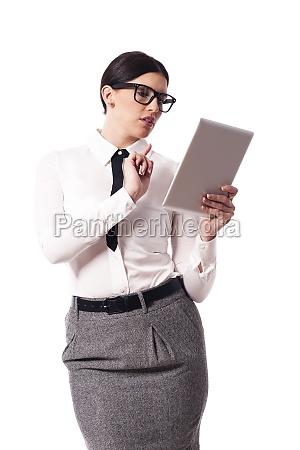 beautiful businesswoman using digital tablet