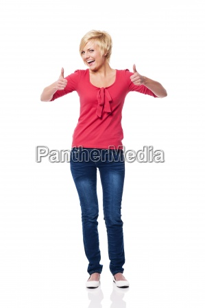 beautiful blonde woman showing thumbs up