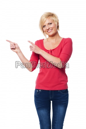 blonde woman pointing at copy space