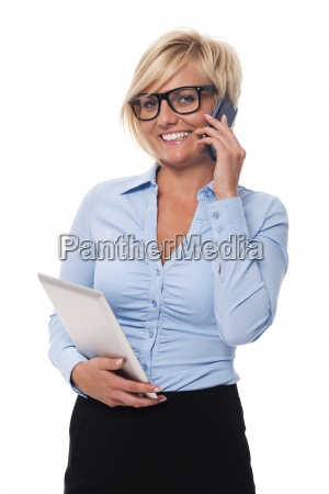 smiling businesswoman with mobile phone and