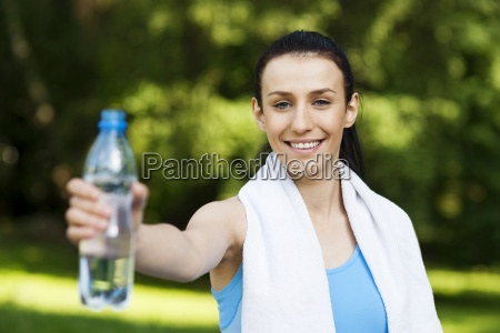 young woman with bottle of water