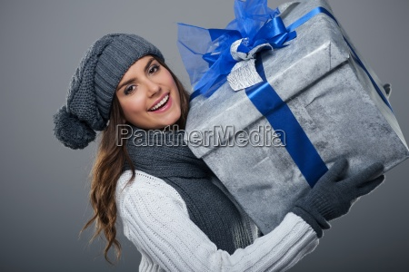 happy woman wearing warm clothing holding