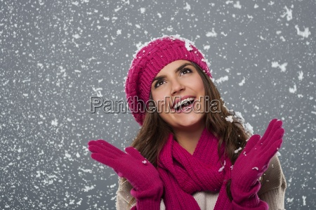 beautiful woman is happy from snow