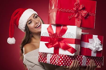 cute young woman wearing santa hat