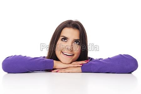 beautiful woman in purple looking at