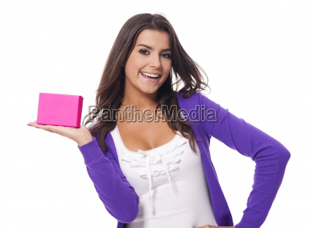 cute young woman holding pink present