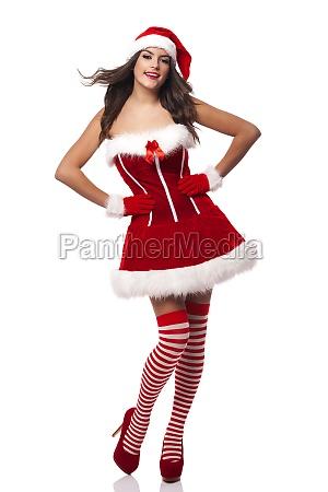 beautiful and smiling santa claus woman