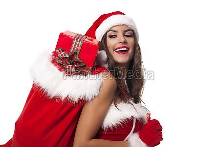 happy woman with sack of santa