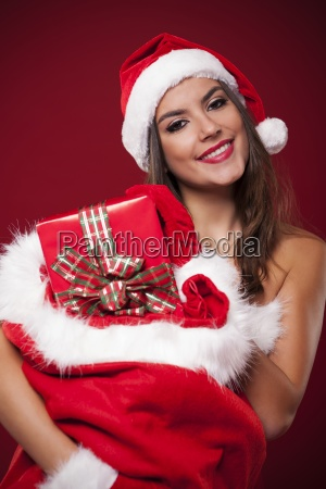 smiling sexy woman holding sack full
