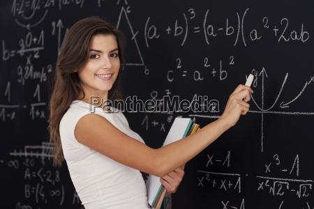 happy woman solving mathematic problems