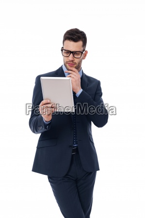focused man working with a digital
