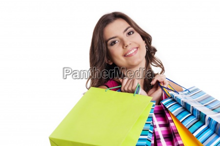 brunette woman with multi colored shopping