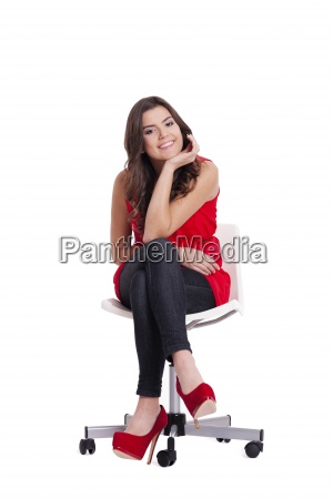 attractive young woman sitting on a