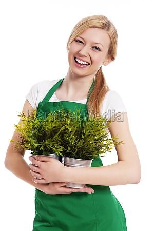 happy gardener female with her plants