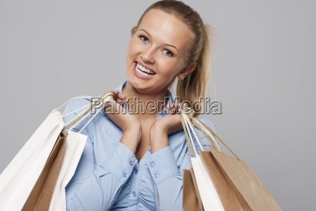 portrait of beautiful shopaholic with shopping