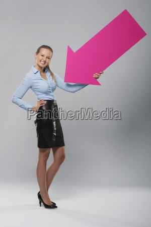 blonde businesswoman with beautiful smile holding