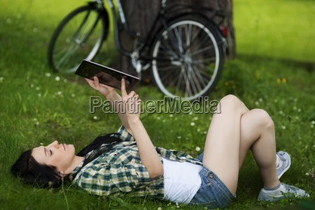 beautiful young woman using digital tablet