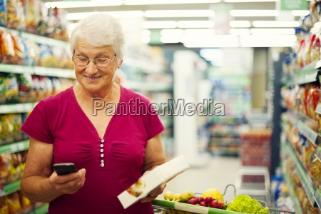 senior woman texting on mobile phone