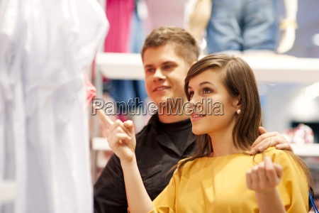 happy couple doing shopping