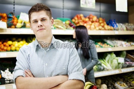 young man standing the front of