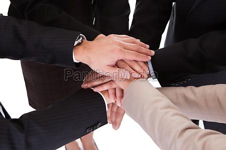 businesspeople holding hands teamwork