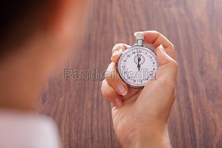 cronômetro, na, mão, fêmea - 12392734