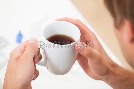 hands lemon tea cup