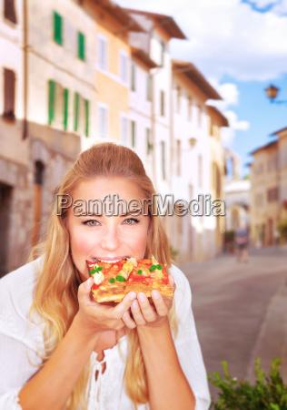 eating italian pizza
