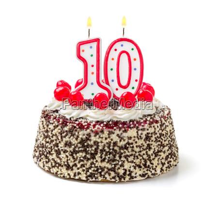 bolo de aniversario com vela ardente