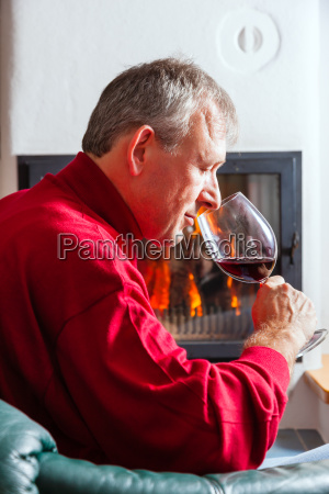 man drinks red wine