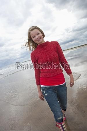 portrait of smiling teenage girl on