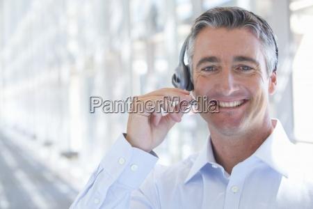 close up portrait of smiling businessman