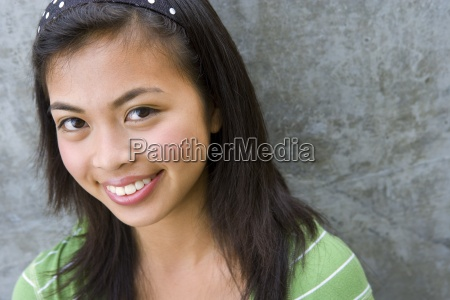 teenage girl 13 15 smiling portrait