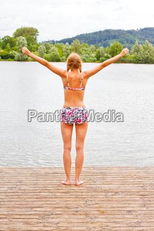 young woman at bathing lake