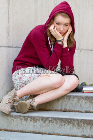 sad student on a staircase
