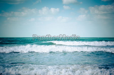 blue sea and white waves