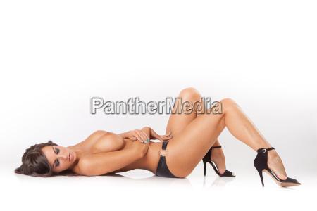 attractive brunette girl lying on white