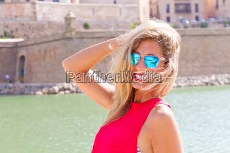 young blond woman with sunglasses in