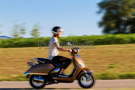 young woman on the scooter