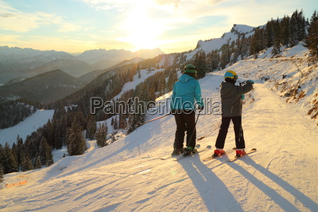 woman with child skiing