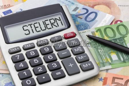 calculadora com contas de dinheiro