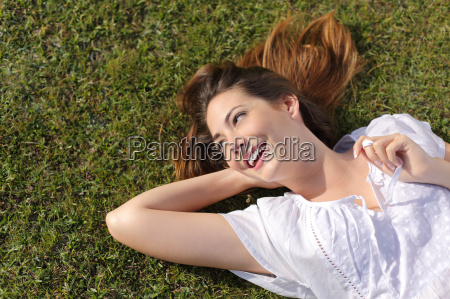 happy relaxed woman lying on the