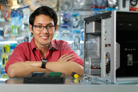 portrait of chinese man with pc