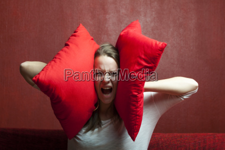 young woman with pillow