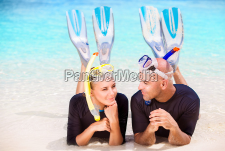 happy divers on the beach