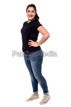 full length of young woman posing